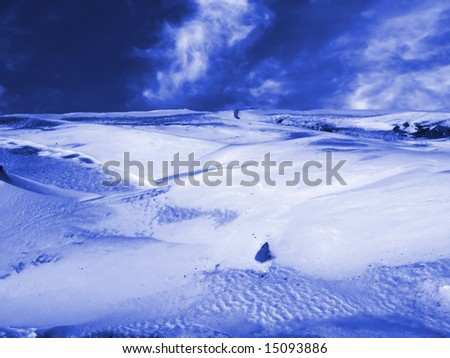 Snow cliff in mountains. Deserted area.