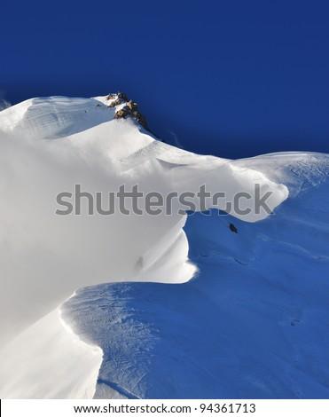 Snow cornice on Mont Blanc du Tacul, France - stock photo