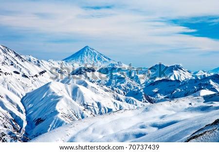 Snow covered beautiful mountain peaks - stock photo