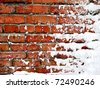snow covered brick wall close up - stock photo