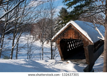 Snow covered bridge after snowfall in New England.. - stock photo