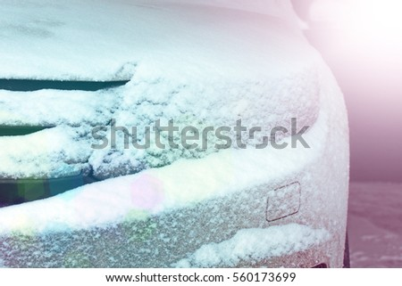 Snow-covered car, front view