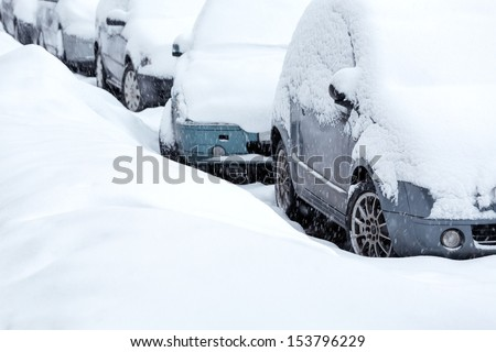 Snow covered cars - stock photo
