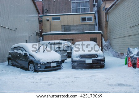 snow covered 2 cars, lots of snow, after snowing  - stock photo