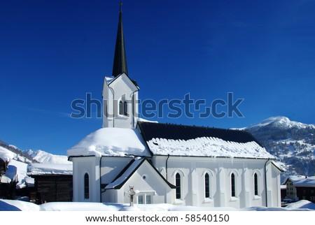 Snow covered church in Ulrichen, Switzerland - stock photo