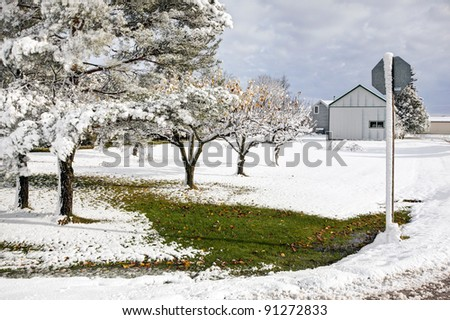 snow covered cottage in winter - stock photo