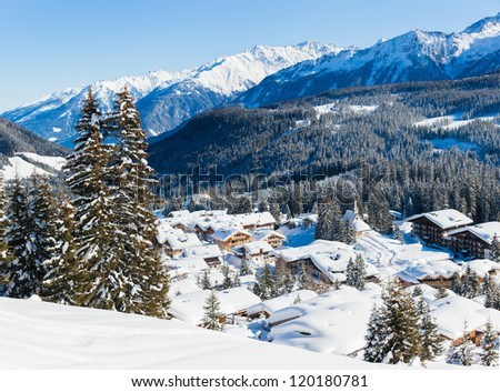 Snow-covered cottages at the Austrian Alps of the Tyrol region. Panorama - stock photo