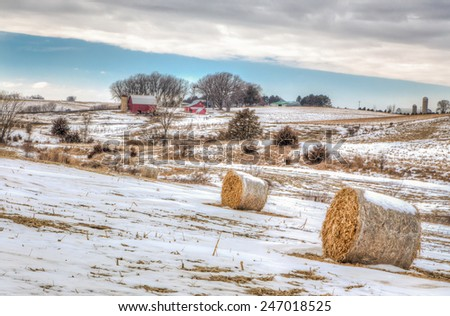 Snow covered farm field in the American midwest. - stock photo