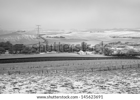 Snow covered farm in Lorraine, France (black and white) - stock photo