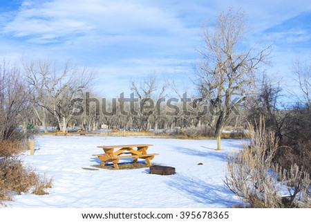 Snow Covered Ground and Picnic Table in Camp Ground