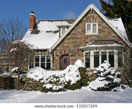 snow covered house - stock photo
