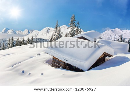 Snow covered hut winter landscape - stock photo