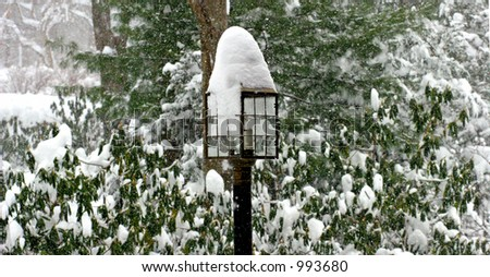 Snow Covered Lamppost - stock photo
