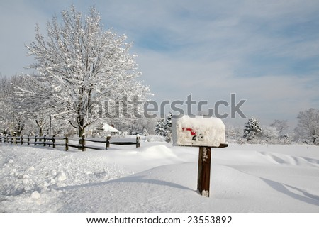 Snow covered mailbox against a cold New England landscape - stock photo