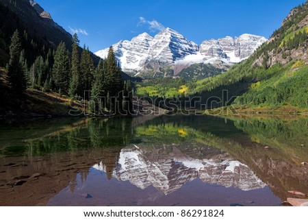 Snow covered Maroon Bells in autumn. - stock photo