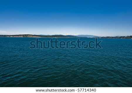 Snow covered Mount Baker from the Puget Sound in Washington state on a beautiful sunny day