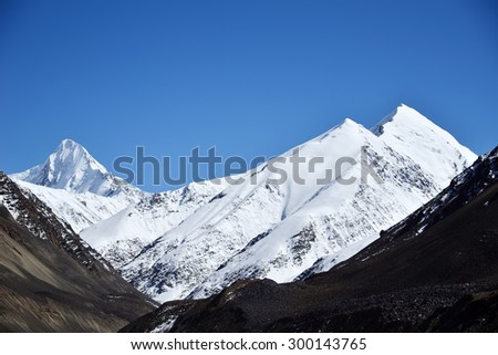 Snow covered mountain peak. Northern of Pakistan. - stock photo