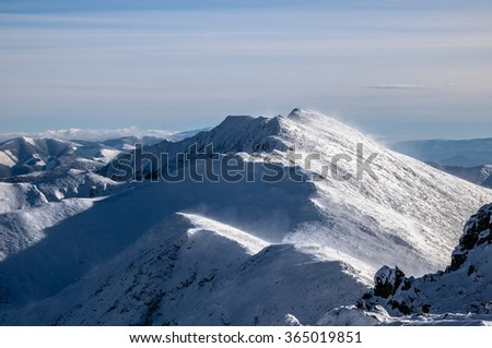 Snow-covered mountain ridge in the wintertime in the Tatras, Slovakia - stock photo