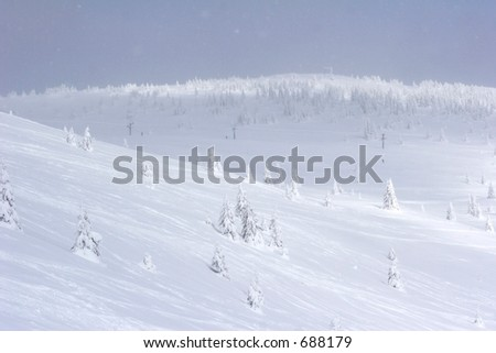 snow covered mountain side - stock photo