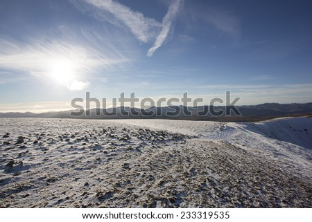 snow covered mountain top in bright sunlight, helvellyn, cumbria