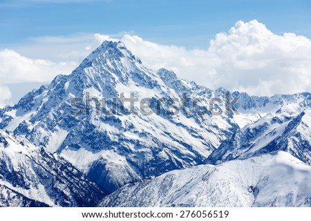 Snow-covered mountain top. Russia, Caucasus, district of the settlement Arkhyz, mountain top Pshish. - stock photo