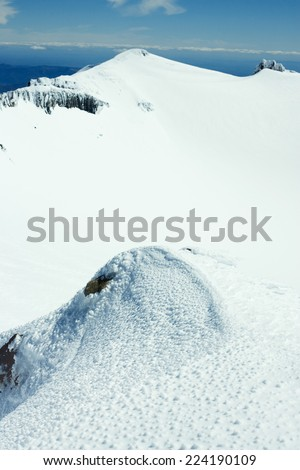 Snow-covered mountainous landscape - stock photo