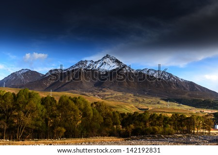 Snow covered mountains and rocky peaks in the mountain - stock photo