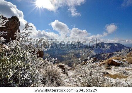 Snow-covered mountains in the southwest desert - stock photo