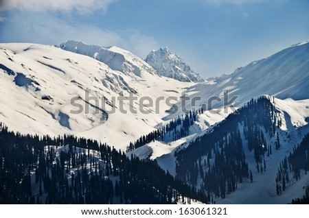 Snow covered mountains in winter, Gulmarg, Jammu And Kashmir, India - stock photo