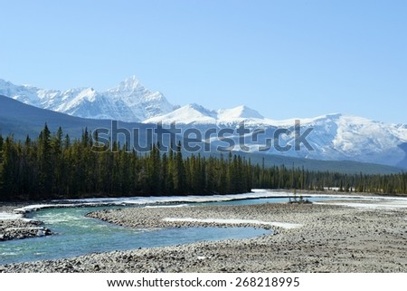 Snow covered Mt  Edith Cavell and Athabasca river in Jasper National Park, Alberta, Canada - stock photo