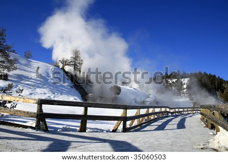 Snow covered path leading up to Mammoth Hot Springs at Yellowstone National Park - stock photo