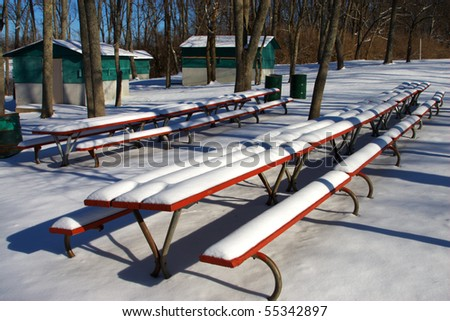 snow covered picnic table - stock photo