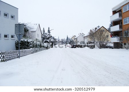Snow-covered residential street daily in Erlangen, Germany