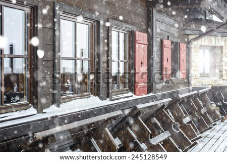 snow-covered restaurant in mountains - stock photo