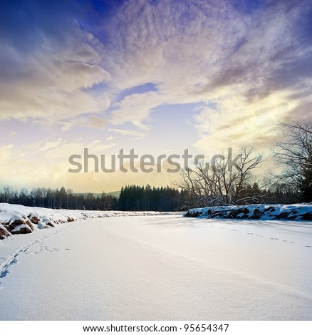 snow covered river and beautiful sunset - stock photo