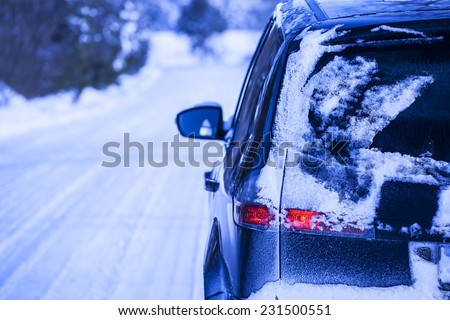 Snow-covered road in winter, car on a dangerous stretch of road covered with snow and ice.