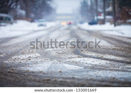 Snow-covered road, the marks of wheels - stock photo