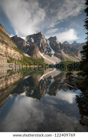 Snow Covered Rocky Mountain Peaks Reflected in Moraine Lake at Banff National Park, Alberta, Canada - stock photo