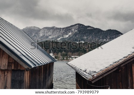Snow covered roof. Winter landscape with snow covered roofs.