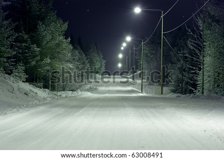 Snow-covered rural road - stock photo