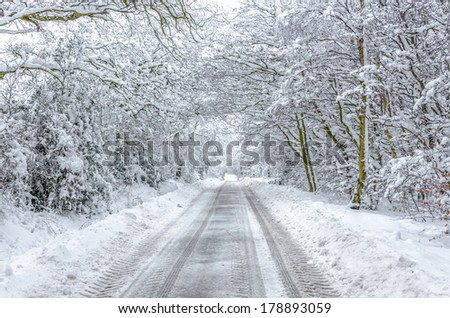 Snow Covered Rural Road in WInter England - stock photo