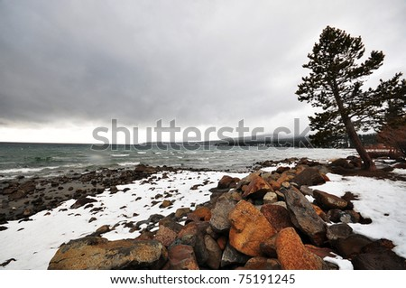 Snow-Covered Shore in Lake Tahoe City, CA - stock photo