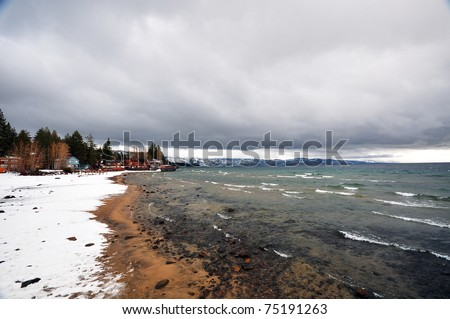 Snow-Covered Shore in Stormy Day in Lake Tahoe City, CA