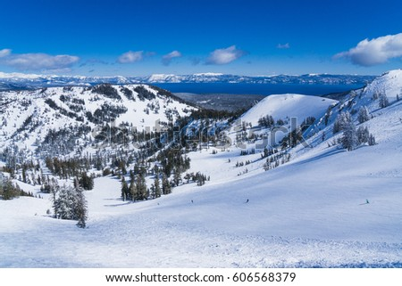 Snow covered slopes of the Sierra Nevada mountains above Lake Tahoe California near a ski resort in winter