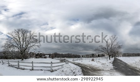 Snow covered stable in rural Maryland in Winter on a gloomy day - stock photo