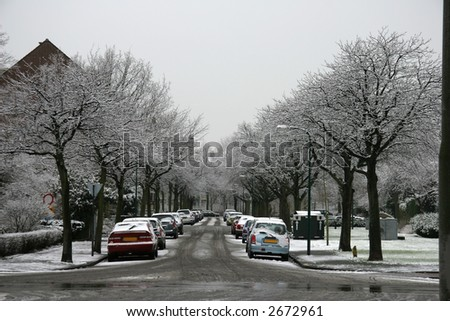 Snow covered street in city - stock photo