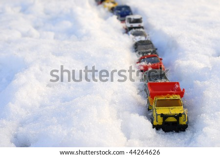 Snow Covered Toy Cars - stock photo