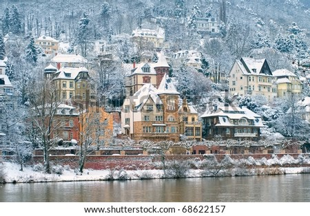 Snow covered traditional mansions in Heidelberg, Germany - stock photo
