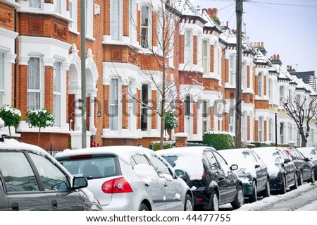 Snow covered Typical English Terraced Houses with  in London. - stock photo