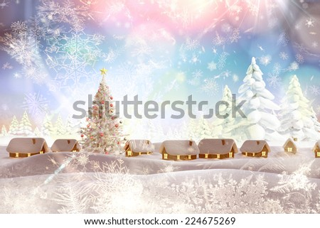 Snow covered village against snowy landscape with fir trees